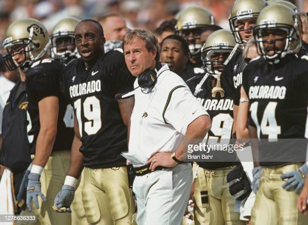 Gary Barnett, Head Coach for the University of Colorado Buffaloes stands with his players on the sideline during the NCAA Big -12 college football...