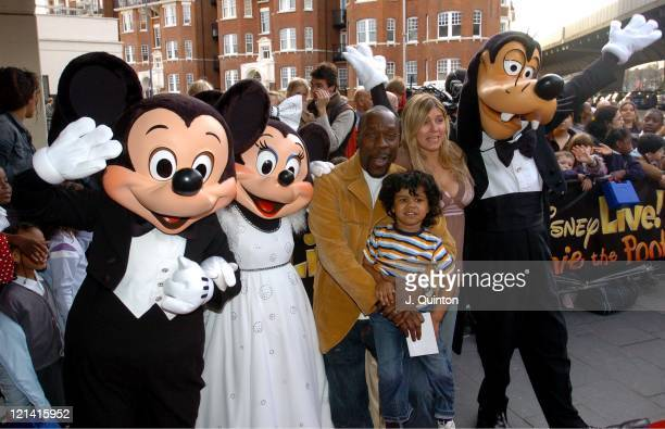 Gary Beadle and family with Mickey Mouse Minnie Mouse and Goofy