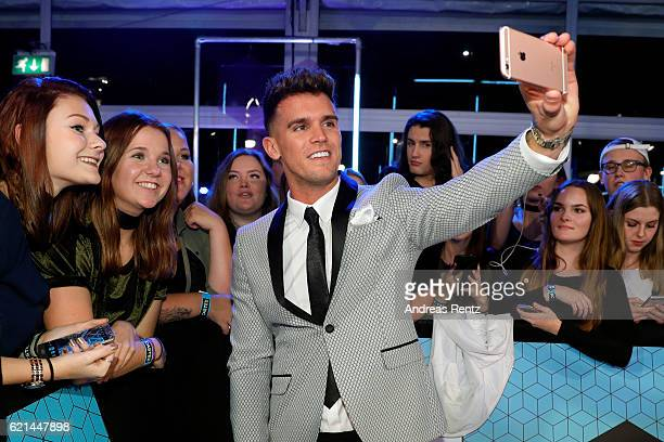 Gary Beadle poses for selfies with fans as he attends the MTV Europe Music Awards 2016 on November 6 2016 in Rotterdam Netherlands