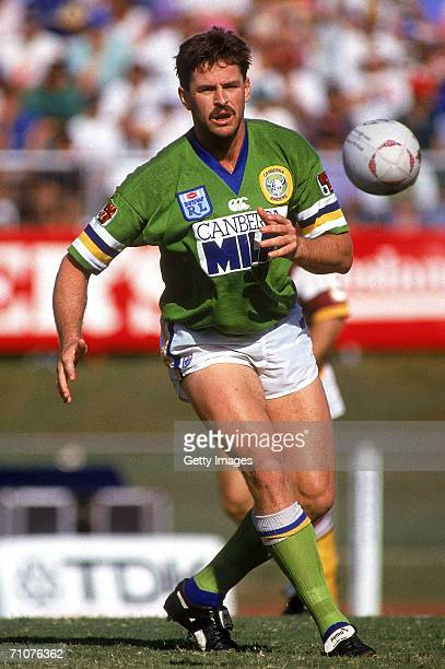 Gary Belcher of the Raiders offloads the ball during a NSWRL match between the Brisbane Broncos and the Canberra Raiders at Lang Park 1993, in...