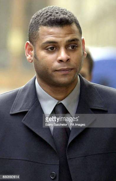 Gary Belgrave arrives at Bristol Crown Court. Mr Belgrave was, giving evidence in the case of four white soldiers accused of murdering a black...