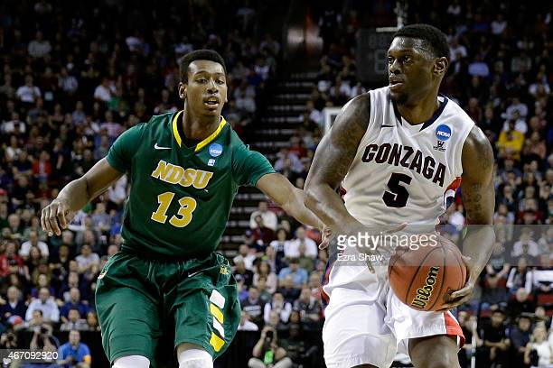 Gary Bell Jr. #5 of the Gonzaga Bulldogs dribbles the ball against Carlin Dupree of the North Dakota State Bison in the first half of the game during...