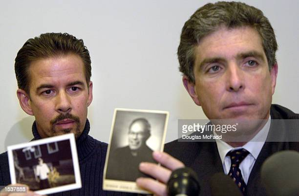 Gary Bergeron sits next to attorney Robert Sherman holding up pictures of David Lyko as an altar boy and Father Joseph Birmingham during a news...