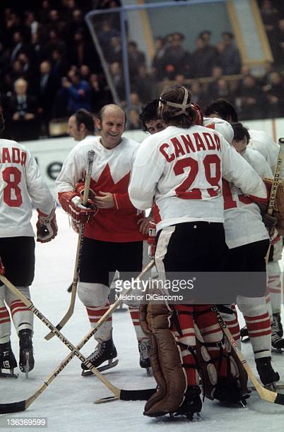 Gary Bergman and goalie Ken Dryden of Canada celebrate with their teammates after Game 6 of the 1972 Summit Series on September 24 1972 at the...