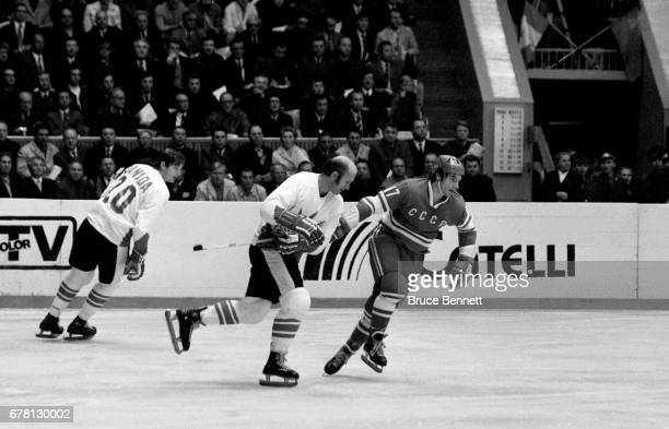 Gary Bergman and Pete Mahovlich of Canada defend against Valeri Kharlamov of the Soviet Union during a game in the 1972 Summit Series circa September...