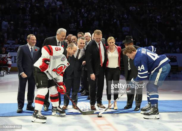 Gary Bettman Alexander Yakushev Martin St Louis Martin Brodeur Jayna Hefford and Willie O'Ree drop the ceremonial puck between Andy Greene of the New...