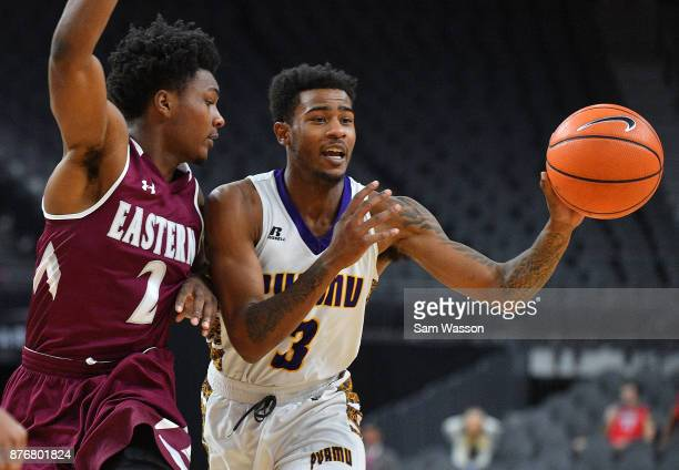 Gary Blackston of the Prairie View AM Panthers is guarded by DeAndre Dishman of the Eastern Kentucky Colonels during day one of the Main Event...