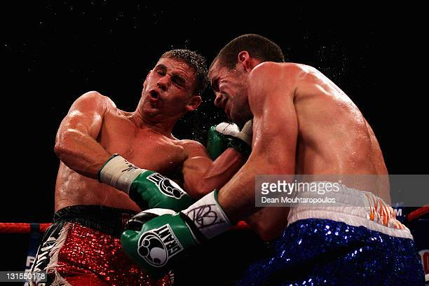 Gary Boulden of England is hit by Billy Joe Saunders of England in their Southern Area Middleweight Championship during Championship Boxing at...