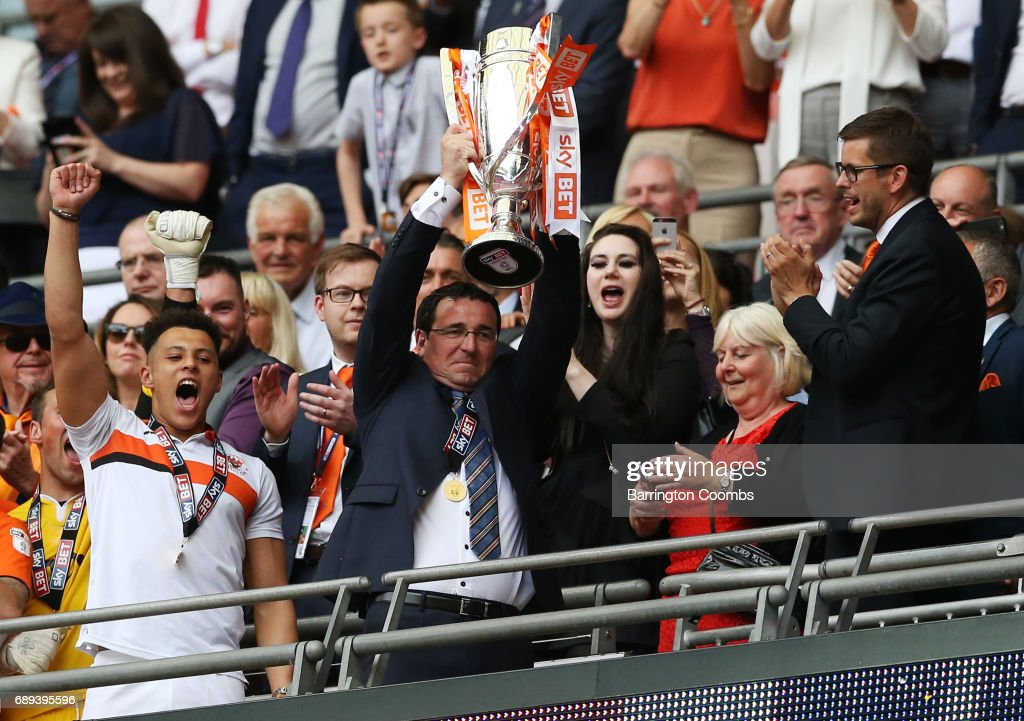 Gary Bowyer manager of Blackpool celebrates victory and promotion with the trophy after the Sky Bet League Two Playoff Final between Blackpool and Exeter City at Wembley Stadium on May 28, 2017 in London, England.