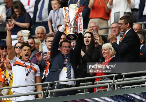 Gary Bowyer manager of Blackpool celebrates victory and promotion with the trophy after the Sky Bet League Two Playoff Final between Blackpool and...