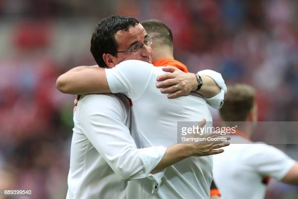 Gary Bowyer manager of Blackpool celebrates victory and promotion with Tom Aldred of Blackpool after the Sky Bet League Two Playoff Final between...