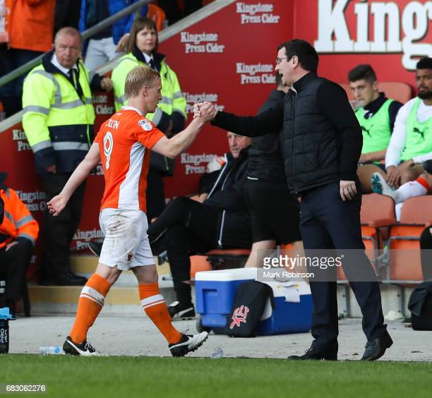 Gary Bowyer manager of Blackpool FC substitutes hatrick hero Mark Cullen of Blackpool during the Sky Bet League Two match between Blackpool and Luton...