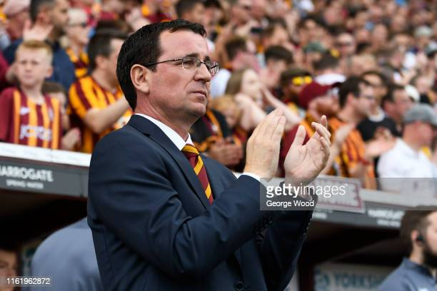 Gary Bowyer manager of Bradford City applauds during the PreSeason Friendly match between Bradford City and Liverpool at Northern Commercials Stadium...