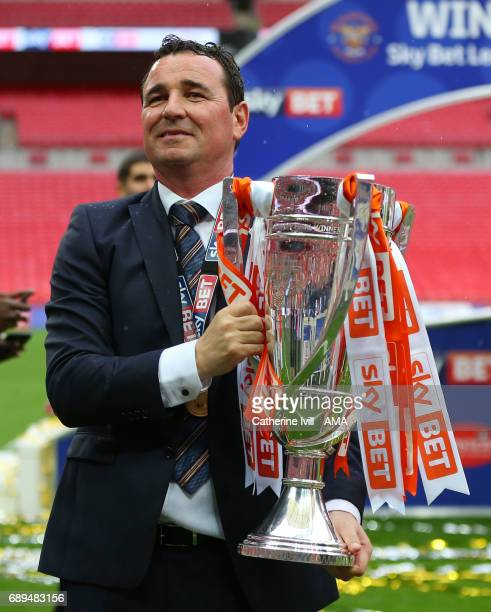 Gary Bowyer the head coach / manager of Blackpool celebrates with the trophy during the Sky Bet League Two Playoff Final match between Blackpool and...