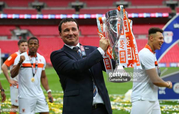 Gary Bowyer the manager of Blackpool celebrates with the trophy during the Sky Bet League Two Playoff Final match between Blackpool and Exeter City...