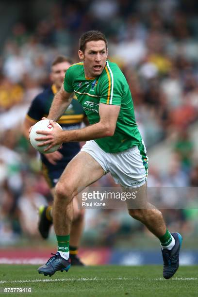 Gary Brennan of Ireland looks to pass the ball during game two of the International Rules Series between Australia and Ireland at Domain Stadium on...
