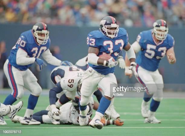 Gary Brown Running Back for the New York Giants runs the ball during the National Football Conference East game against the Denver Broncos on 13...