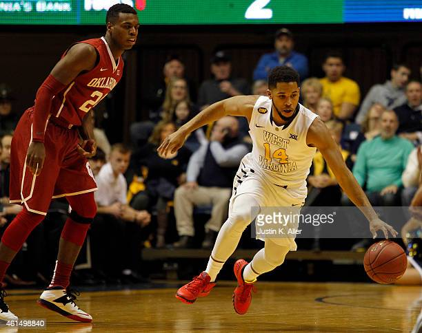 Gary Browne of the West Virginia Mountaineers handles the ball against Buddy Hield of the Oklahoma Sooners during the game at the WVU Coliseum on...