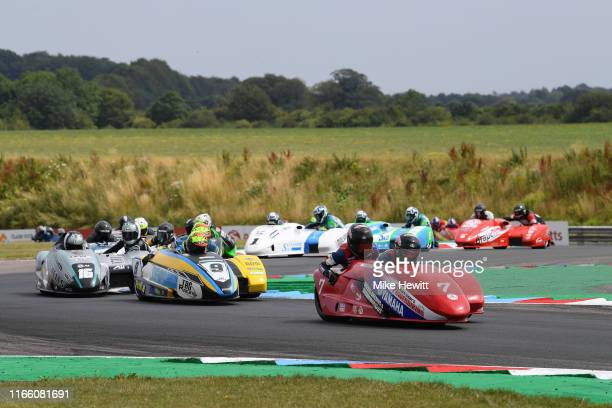 Gary Bryan and Phil Hyde of Great Britain lead at the start of the British Sidecar Race in the British Superbikes Championships at Thruxton Circuit...