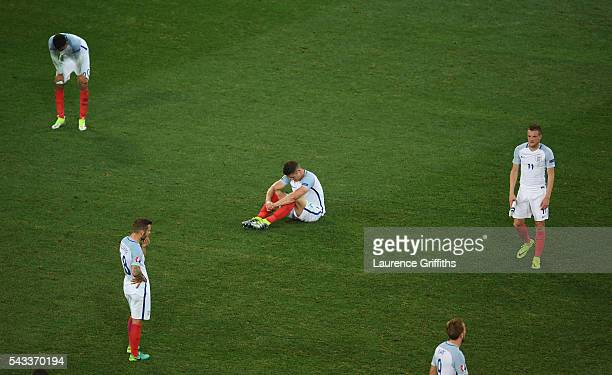 Gary Cahill and England players show their dejection after the UEFA EURO 2016 round of 16 match between England and Iceland at Allianz Riviera...
