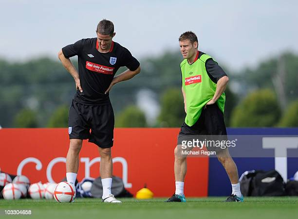 Gary Cahill and James Milner warm up during the England training session at London Colney on August 9, 2010 in St Albans, England.