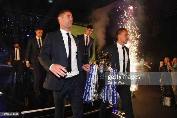 Gary Cahill and John Terry of Chelsea walk out with the Premier League trophy during the Chelsea Player of the Year awards at Battersea Evolution on...