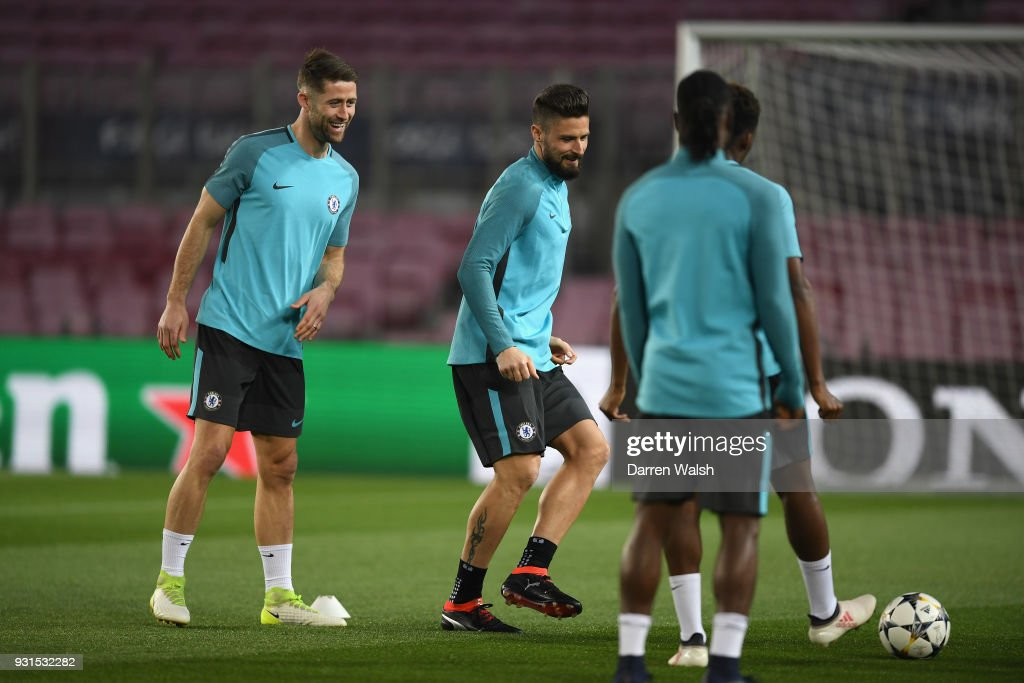 Gary Cahill and Olivier Giroud of Chelsea during a training session at Nou Camp on March 13, 2018 in Barcelona, Spain.
