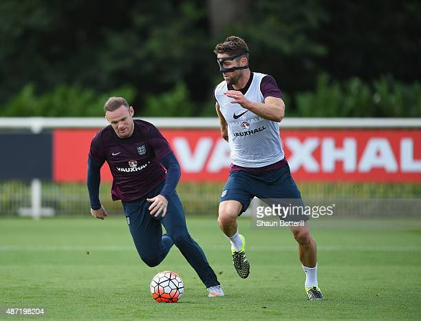 Gary Cahill and Wayne Rooney of England during a training session at Tottenham Hotspur Training Centre on September 7 2015 in Enfield England