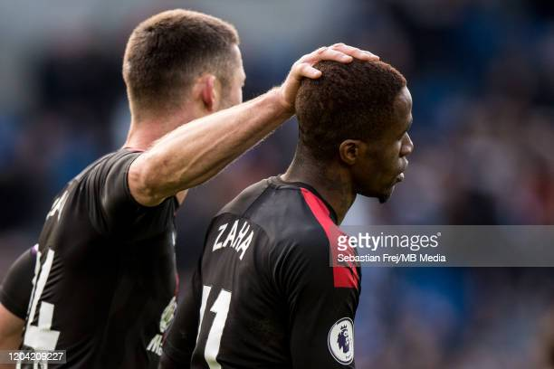 Gary Cahill and Wilfried Zaha of Crystal Palace reacts during the Premier League match between Brighton Hove Albion and Crystal Palace at American...
