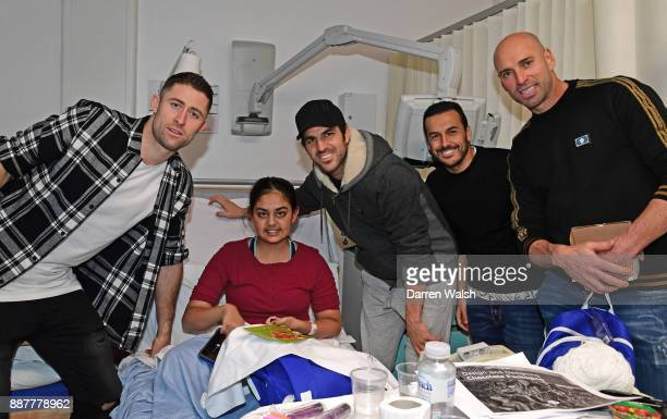 Gary Cahill Cesc Fabregas Pedro and Willy Caballero of Chelsea at the Chelsea and Westminster Hospital on December 7 2017 in London England