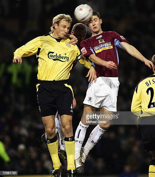 Gary Cahill of Burnley challenges Zak Whitbread of Liverpool during the FA Cup third round match between Burnley and Liverpool at Turf Moor on...