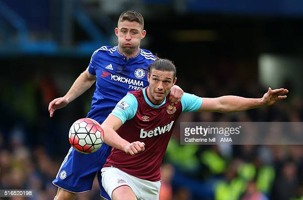 Gary Cahill of Chelsea and Andy Carroll of West Ham United during the Barclays Premier League match between Chelsea and West Ham United at Stamford...