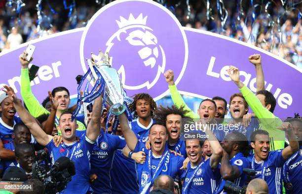 Gary Cahill of Chelsea and John Terry of Chelsea lift the Preimer Leauge Trophy after the Premier League match between Chelsea and Sunderland at...