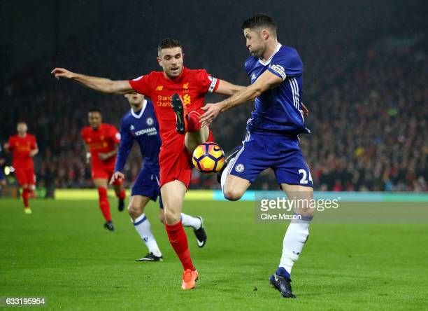 Gary Cahill of Chelsea and Jordan Henderson of Liverpool compete for the ball during the Premier League match between Liverpool and Chelsea at...
