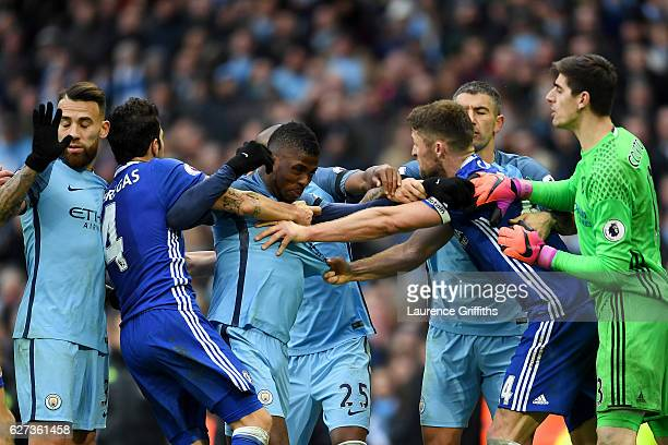 Gary Cahill of Chelsea and Kelechi Iheanacho of Manchester City square off while other players try to separate them during the Premier League match...