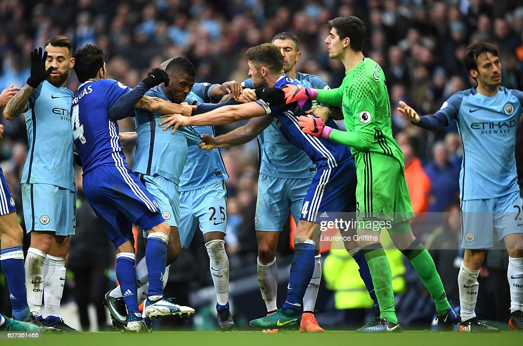 Gary Cahill of Chelsea and Kelechi Iheanacho of Manchester City square off while other players try to separate them during the Premier League match between Manchester City and Chelsea at Etihad Stadium on December 3, 2016 in Manchester, England.