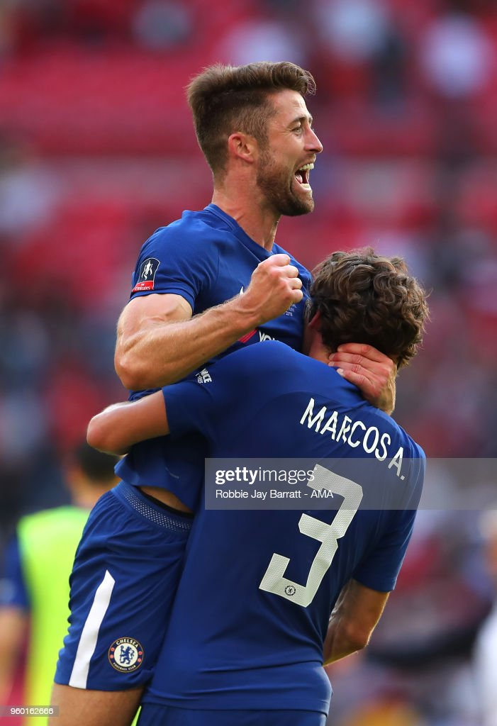 Gary Cahill of Chelsea and Marcos Alonso celebrate at the end of the Emirates FA Cup Final between Chelsea and Manchester United at Wembley Stadium on May 19, 2018 in London, England.