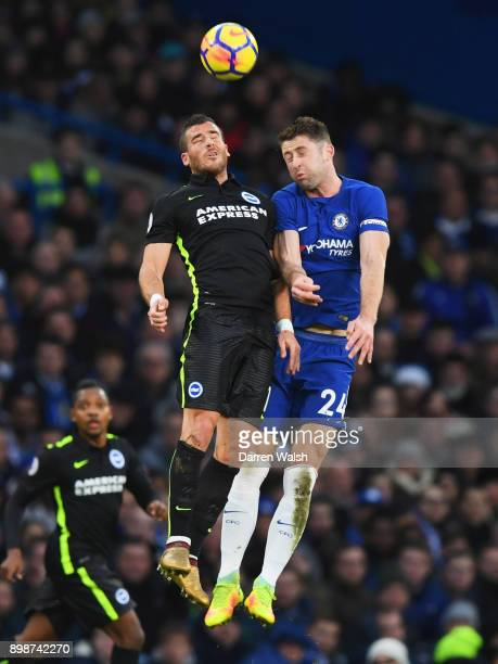 Gary Cahill of Chelsea and Tomer Hemed of Brighton and Hove Albion jump for the ball during the Premier League match between Chelsea and Brighton and...