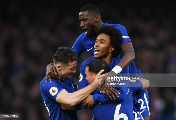 Gary Cahill of Chelsea Antonio Rudiger and Willian of Chelsea congratulate Danny Drinkwater of Chelsea after he scored his team's second goal during...