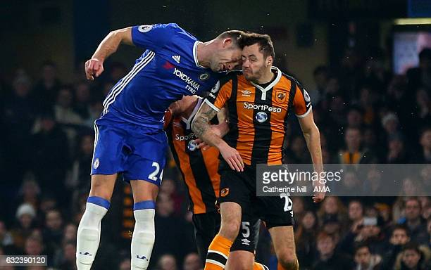 Gary Cahill of Chelsea bangs heads with Ryan Mason of Hull City during the Premier League match between Chelsea and Hull City at Stamford Bridge on...