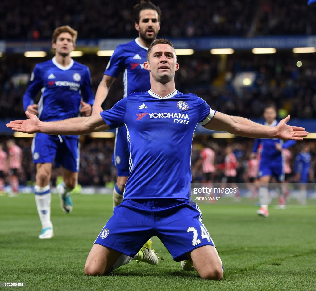 Gary Cahill of Chelsea (front) celebrates as he scores their second goal with team mates during the Premier League match between Chelsea and Southampton at Stamford Bridge on April 25, 2017 in London, England.