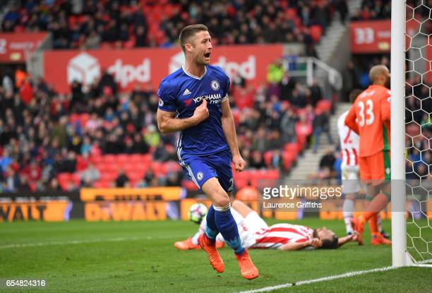 Gary Cahill of Chelsea celebrates scoring his sides second goal during the Premier League match between Stoke City and Chelsea at Bet365 Stadium on...
