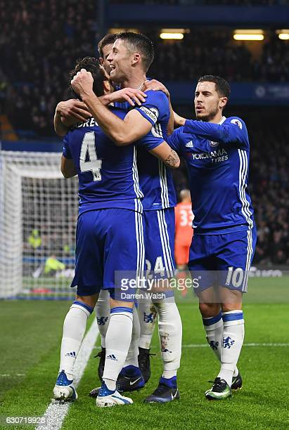 Gary Cahill of Chelsea celebrates scoring his team's first goal with his team mates during the Premier League match between Chelsea and Stoke City at...