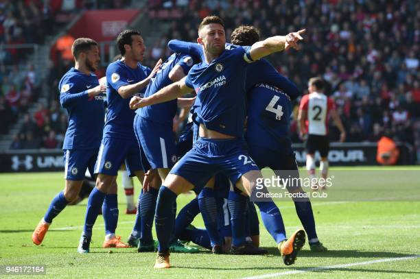Gary Cahill of Chelsea celebrates teammate Olivier Giroud's second and his sides third goal during the Premier League match between Southampton and...