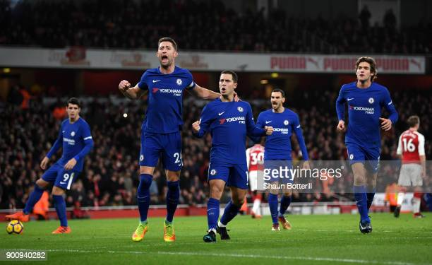 Gary Cahill of Chelsea celebrates with Eden Hazard of Chelsea after he scores his sides first goal from the penalty spot during the Premier League...