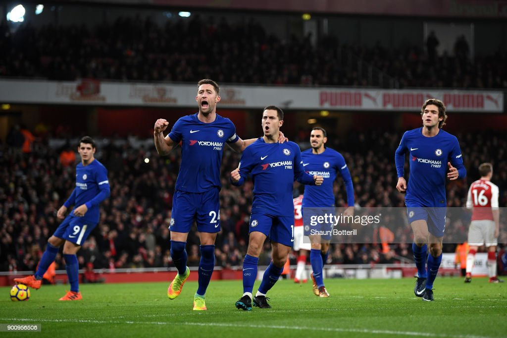 Gary Cahill of Chelsea celebrates with Eden Hazard of Chelsea after he scores his sides first goal from the penalty spot during the Premier League match between Arsenal and Chelsea at Emirates Stadium on January 3, 2018 in London, England.