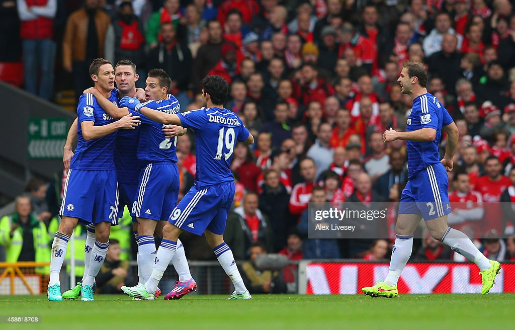 Gary Cahill of Chelsea celebrates with team mates after scoring their first goal during the Barclays Premier League match between Liverpool and Chelsea at Anfield on November 8, 2014 in Liverpool, England.