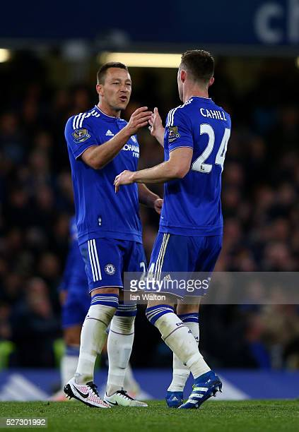Gary Cahill of Chelsea celebrates with teammate John Terry after scoring his team's first goal during the Barclays Premier League match between...
