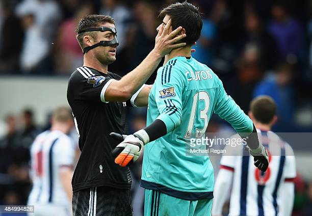 Gary Cahill of Chelsea celebrates with Thibaut Courtois of Chelsea after the Barclays Premier League match between West Bromwich Albion and Chelsea...