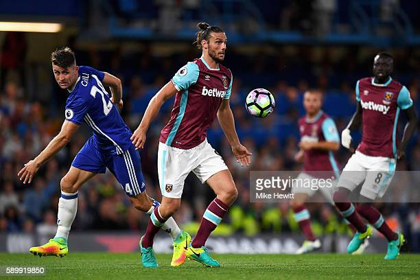 Gary Cahill of Chelsea challenges Andy Carroll of West Ham United during the Premier League match between Chelsea and West Ham United at Stamford...